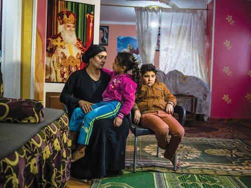 Abanoub, Nijar, and their mother Hania at home.
